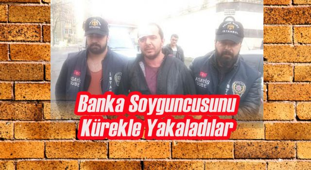 Banka soyguncusunu kürekle vurarak yakladılar